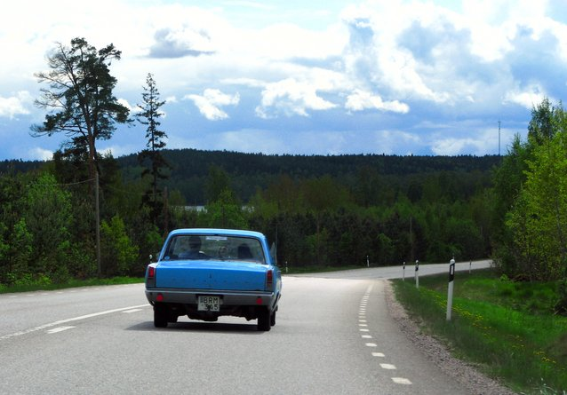 image of a single car on a road