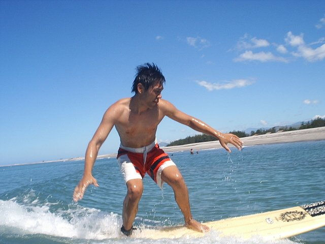Image of man on surf board