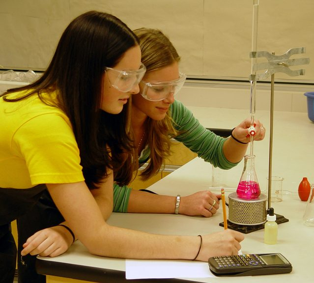 Image of science students conducting an experiment