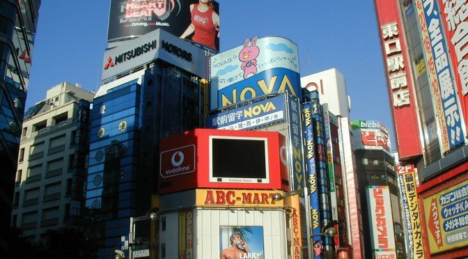 Image of adverts on street corner in Shinjuku