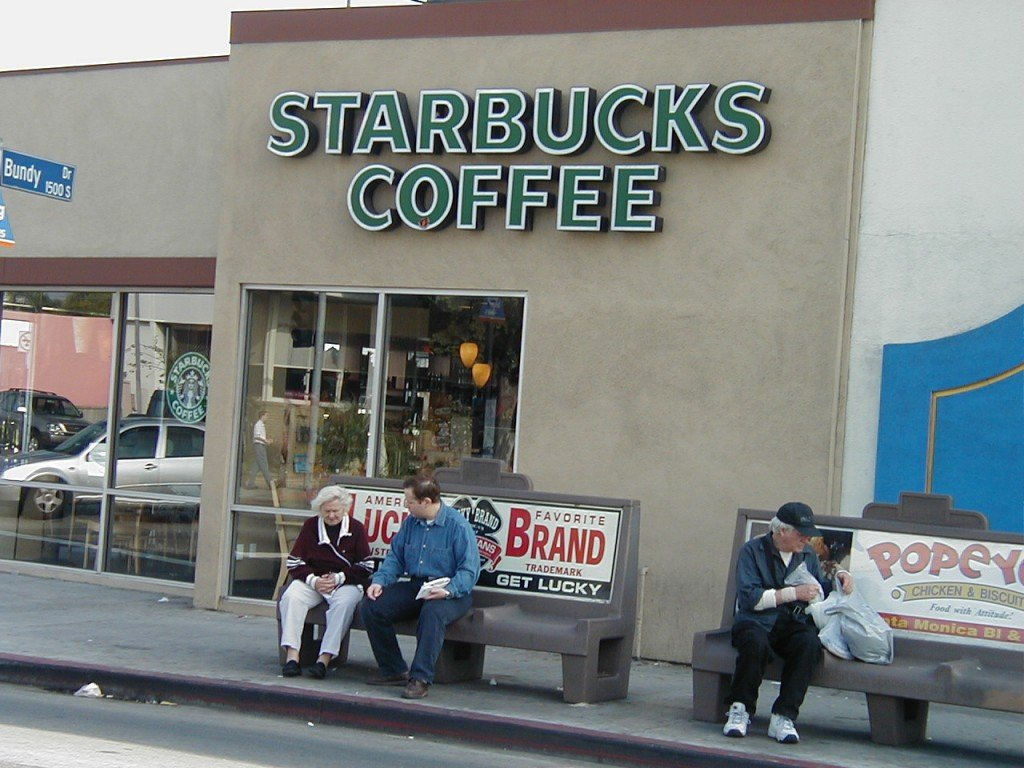 image of people sitting outside Starbucks