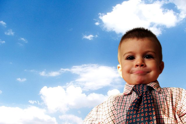 Image of boy dressed in business clothes