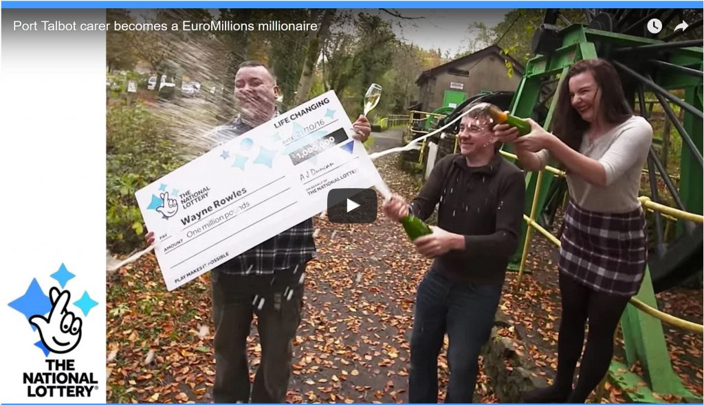 Image of lottery winner with cheque